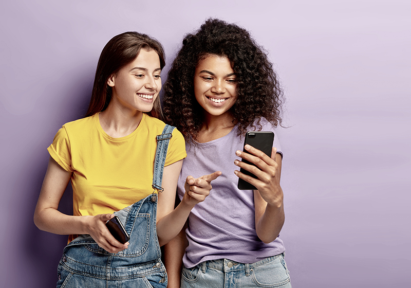 Girls watching something on a mobile